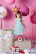 Pretty girl child 4 years old in a blue dress. Baby in Rose quartz room Stock Photos