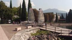 RIVA DEL GARDA, ITALY - Sept 13, 2016: Yachts on harbor in Riva del Garda Stock Footage