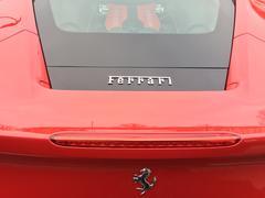 Berlin, Germany - December 19, 2016: Ferrari emblem on a red car Kuvituskuvat