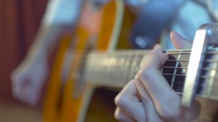Hands of a musician playing the acoustic guitar Stock Footage