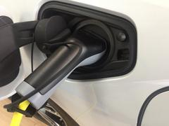 Detail of electric vehicle being charged at station Stock Photos