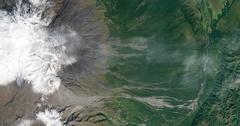High-altitude overflight aerial of volcanic tundra, Kamchatka peninsula, Russia Stock Footage