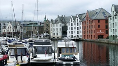 Harbour with boats and colorful houses in Alesund Stock Footage