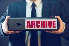 Businessman with archive files in document ring binder Stock Photos