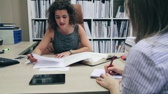 Businesswoman and secretary working with documents in office Stock Footage