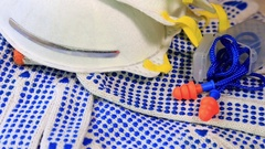Thin work gloves with blue pimples, respirators and ear plugs Stock Footage