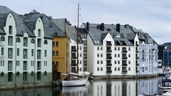 Sailboat in front of the colorful houses in Alesund Stock Footage