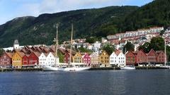 Sailboat in front of Bryggen (the dock) Tyskebryggen buildings Stock Footage