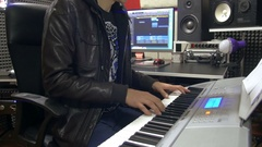 Arranger hands playing keyboards in recording studio for music production Stock Footage