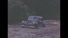 Vintage 16mm film, 1946 BC, car stuck in mud, Caribou highway Stock Footage