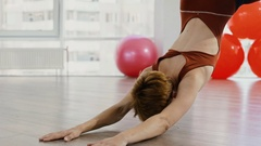 Mature woman doing poses of aerial yoga using hammock Stock Footage