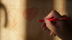 Write on a wooden board with crayons declaration of love, 4k Stock Footage