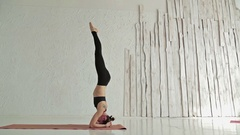 Young sporty woman practicing yoga in fitness studio Stock Footage