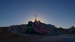 Timelapse of Sunrise over Famous Painted Landscape in Slab City -Tilt Down- Stock Footage