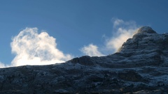 Timelapse of winter clouds in high snowy mountains Stock Footage