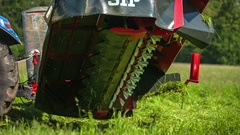 Blue tractor drives up a bit and then it stops Stock Footage