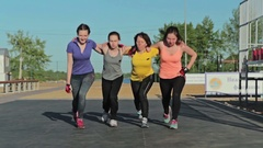 Girls do fitness exercise steps together Stock Footage