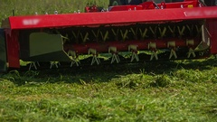 Freshly cut grass is coming out of the machinery Stock Footage