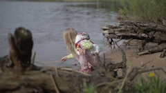 Pretty blond girl with a pattern on the face  fishing in the lake. Stock Footage