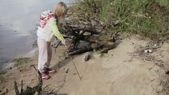 Little girl on the beach of the lake. Stock Footage