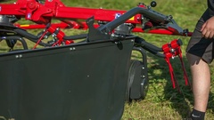 Pulling something up on the machinery with rotary rakes Stock Footage