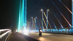 The Bai Chay Bridge in Ha Long, Traffic at night. Vietnam Stock Footage