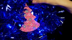 Woman deccorating Christmas tree with little paper tree. Stock Footage