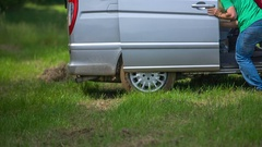 Trying to push the van so that it would move Stock Footage
