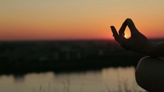 Sporty woman in lotus position in the park at sunset Stock Footage