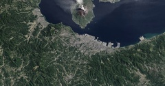 High-altitude overflight aerial of  the Sakura-jima volcano, Kyushu Island Japan Stock Footage