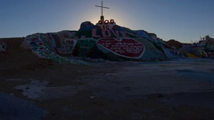 Timelapse of Sunrise over Famous Painted Landscape in Slab City -Tilt Up- Stock Footage