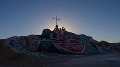 Timelapse of Sunrise over Famous Painted Landscape in Slab City -Zoom Out- Stock Footage