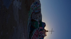 Timelapse of Sunrise over Famous Painted Landscape in Slab City -Vertical/Pan- Stock Footage