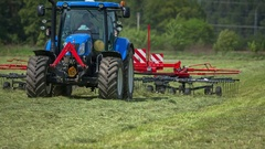 Rotary hay rakes is moving fast when a farmer is preparing hay Stock Footage