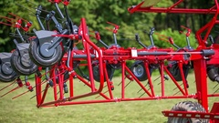 Rotary hay rakes are automatically closing together Stock Footage