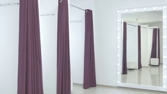 Blackout curtains in dressing room of showroom Stock Footage