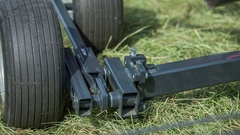 Rotary hay rake lifts up and starts moving Stock Footage