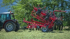 Parts of the rotary hay rakes slowly fold down Stock Footage