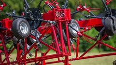 Both parts of rotary hay rakes close together Stock Footage