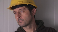 Serious construction worker with protective yellow helmet Stock Footage