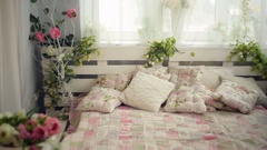 Bed in the bedroom with flowers rustic style Stock Footage