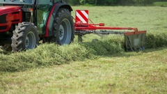 Preparing hay with a rotary hay rake Stock Footage