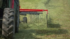 Rotary hay rake when working on the mown grass Stock Footage