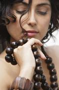 Woman with wooden beads Stock Photos
