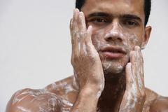 Man covering in soap suds Stock Photos