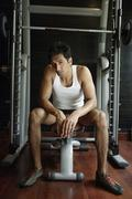 Man on work out equipment Stock Photos