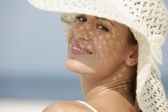 Portrait of woman in sun hat Stock Photos