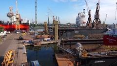 Shipyard crane and dry dock. Gdańsk shipyard. Poland Stock Footage