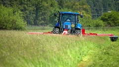 Farmer needs to cut a large lawn with the grass cutting machinery Stock Footage