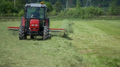 Farmer is working and preparing hay on a hot summer day Stock Footage